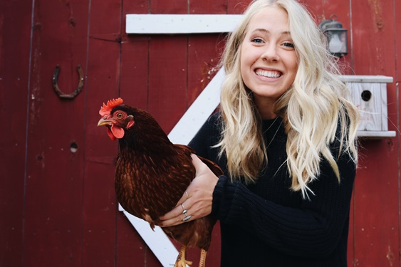 Claire Fellows with a chicken
